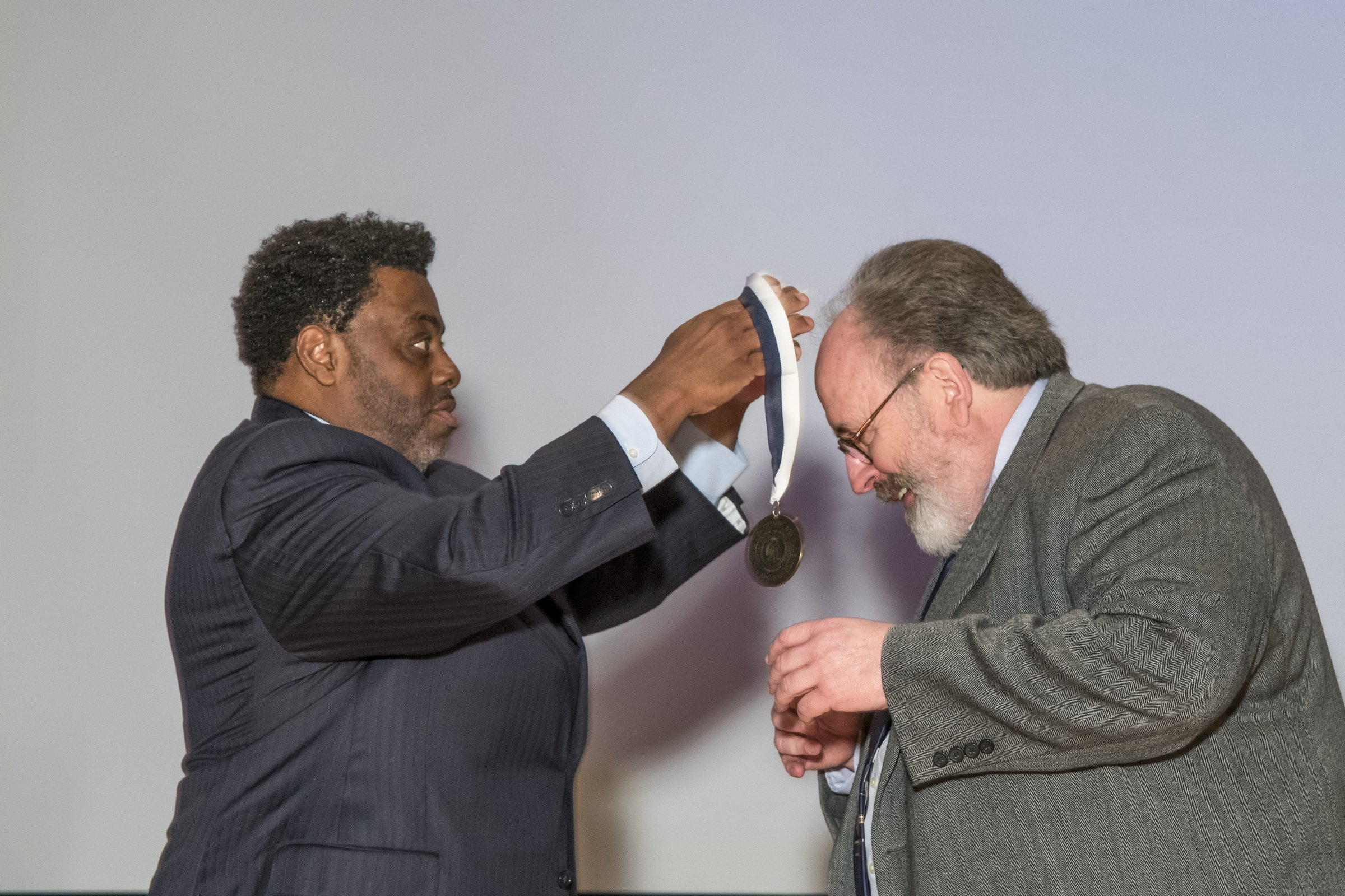 Photo of Chancellor Gilliam presenting an award to a male