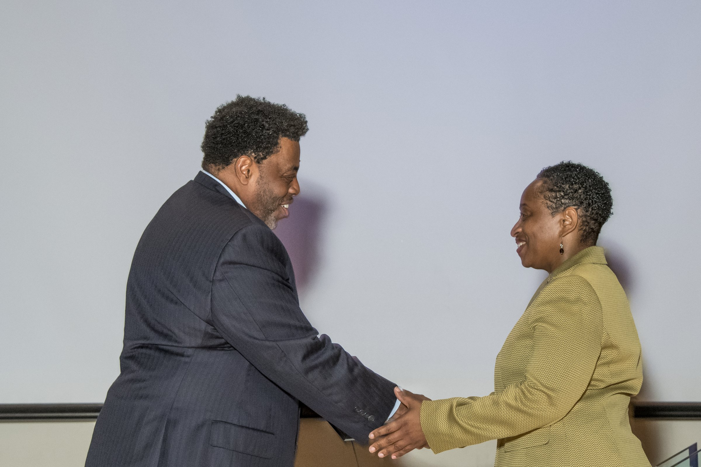 Photo of Chancellor Gilliam presenting an award to a female