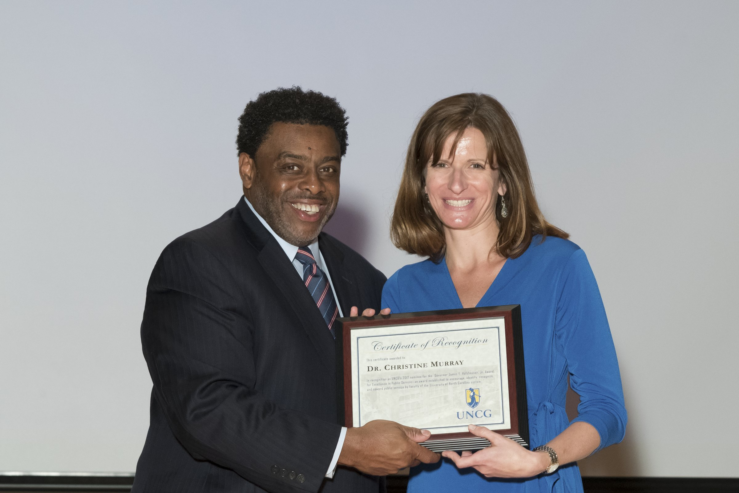 Photo of Chancellor Gilliam with a female award recipient