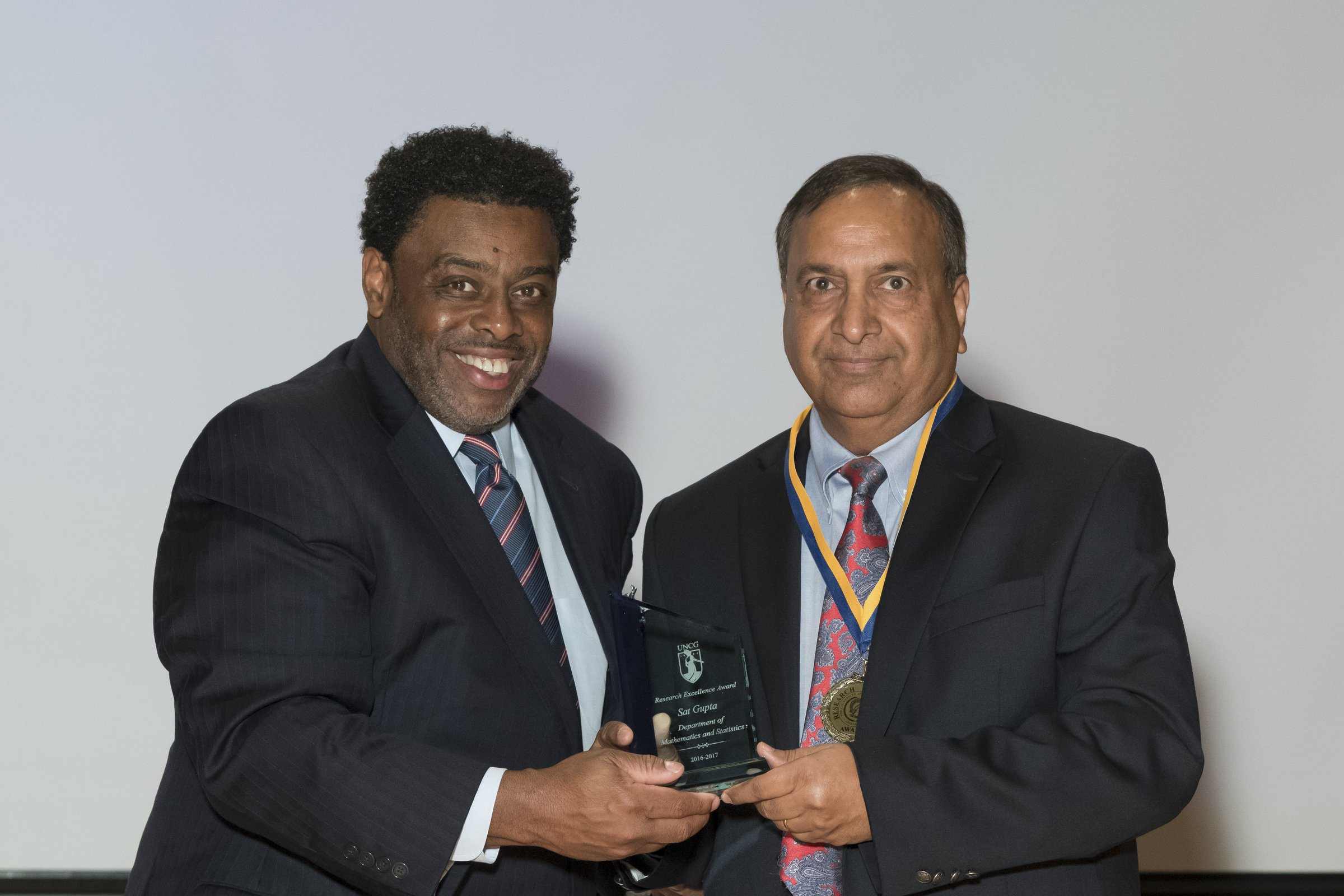 Photo of Chancellor Gilliam with a male award recipient