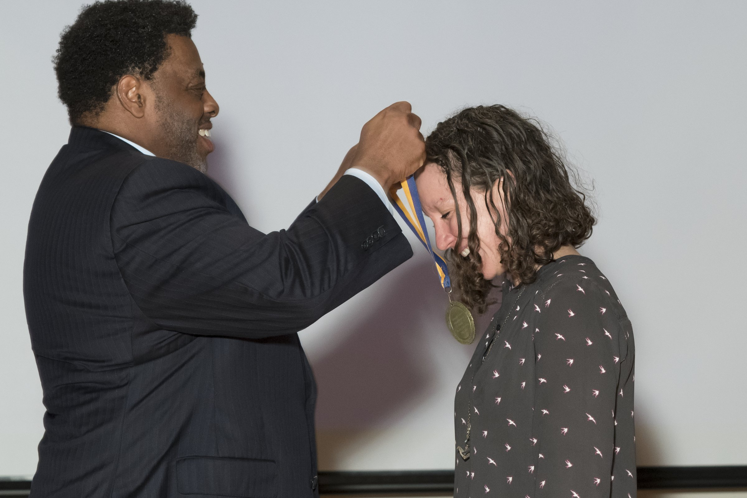 Photo of Chancellor Gilliam presenting an award to a female recipient