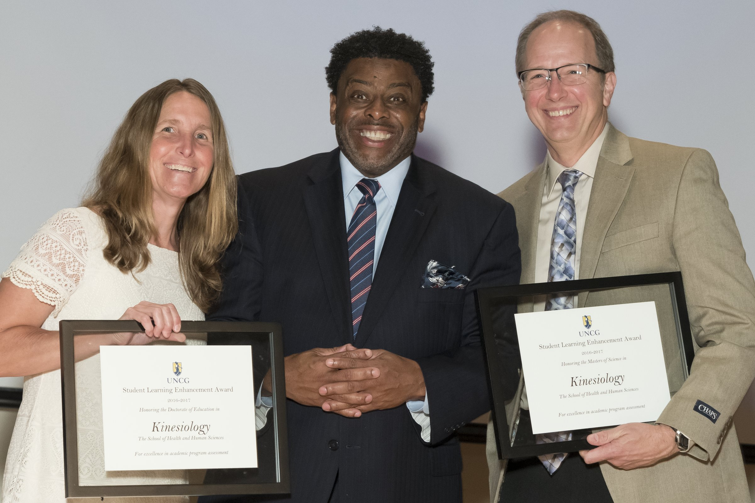 Photo of Chancellor Gilliam with a female and a male award recipient