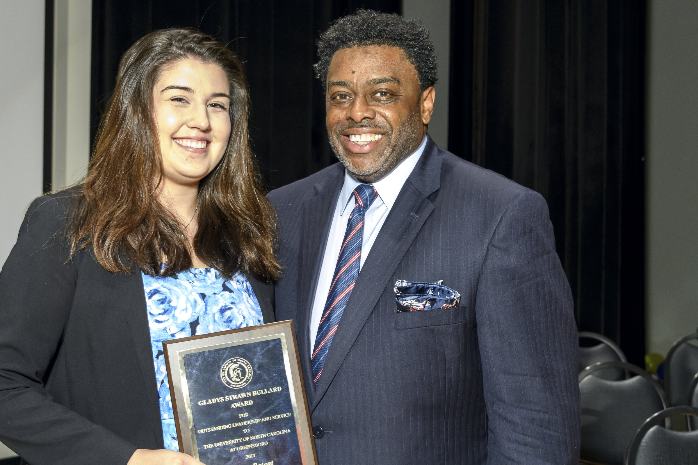 Photo of Chancellor presenting award to a female