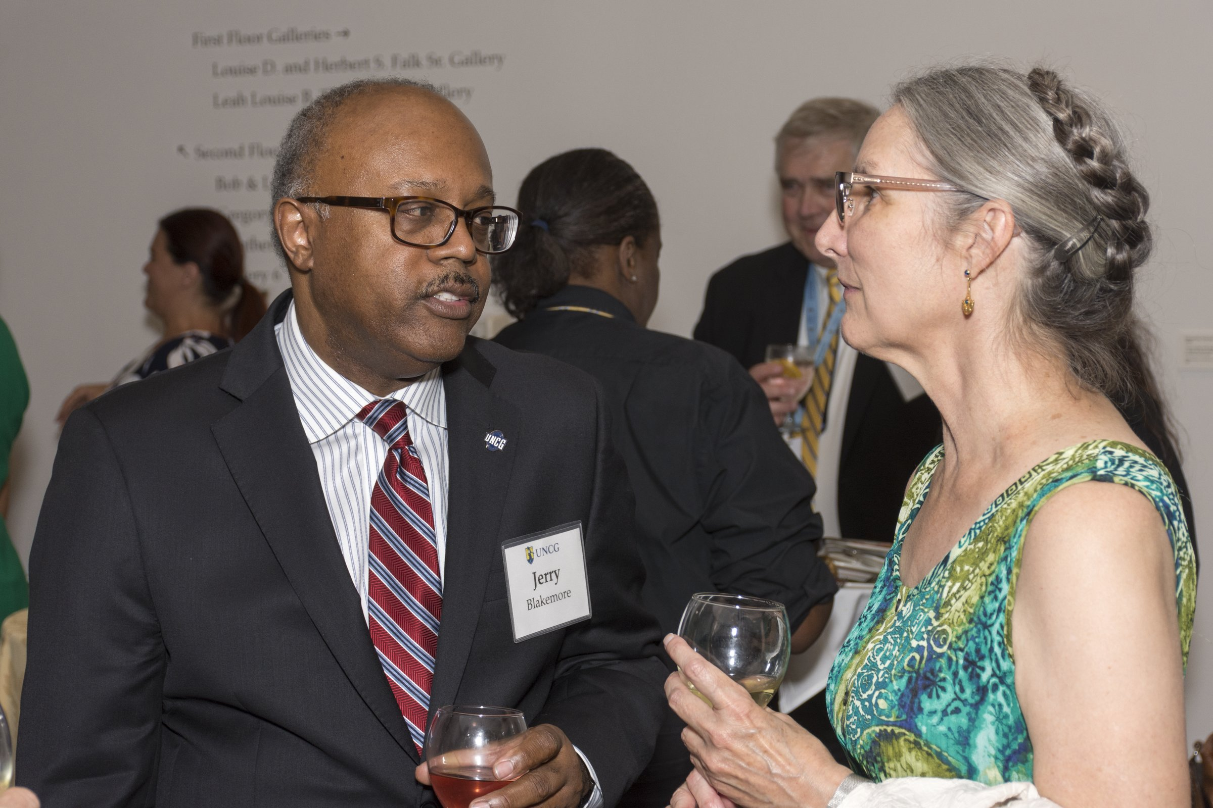 Jerry Blakemore talking with a guest at the reception