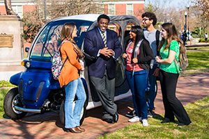 Chancellor Gilliam with students in front of the Warrior Whip.