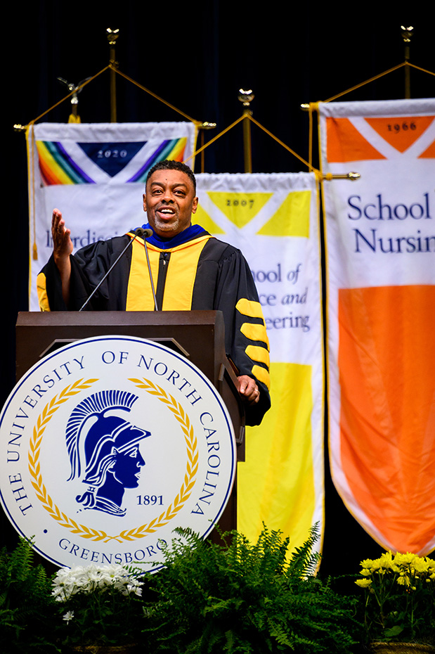 Chancellor Gilliam at the podium speaking at a Commencement ceremony for the Class of 2021