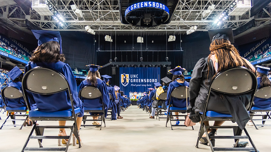Socially-distanced graduating students seated at a Class of 2020 Commencement ceremony